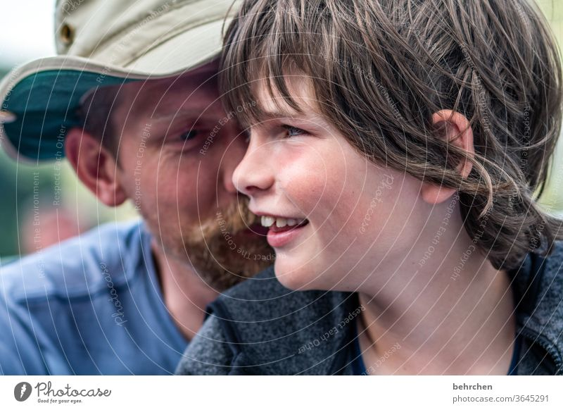 mysteries luck Facial hair Face Child Boy (child) portrait Light Detail Warm-heartedness Safety (feeling of) Trust Colour photo Day Son Love Together