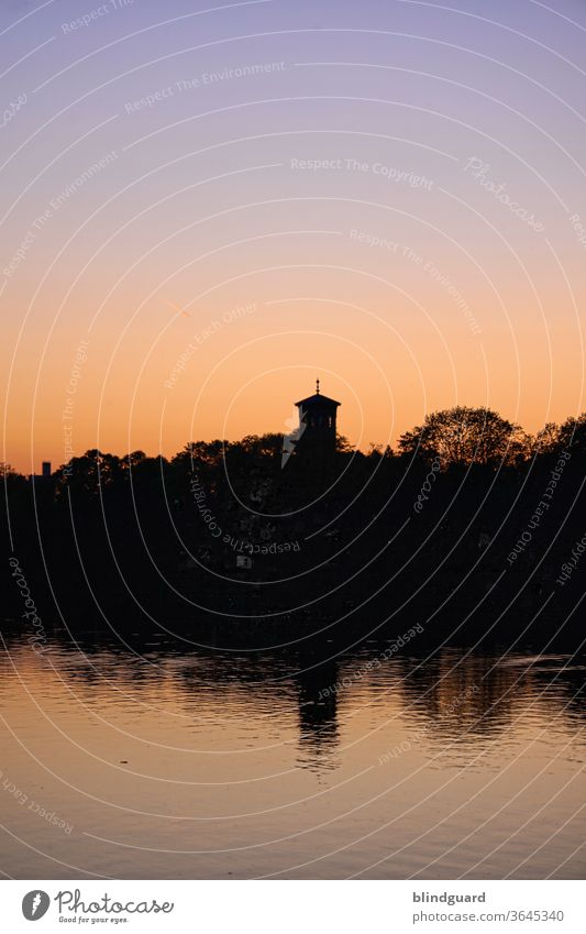 Evening atmosphere at the Main in Hanau Sunset Sky Dusk Nature River Water Inland navigation Church spire Waves Wet Colour photo Deserted Navigation Light