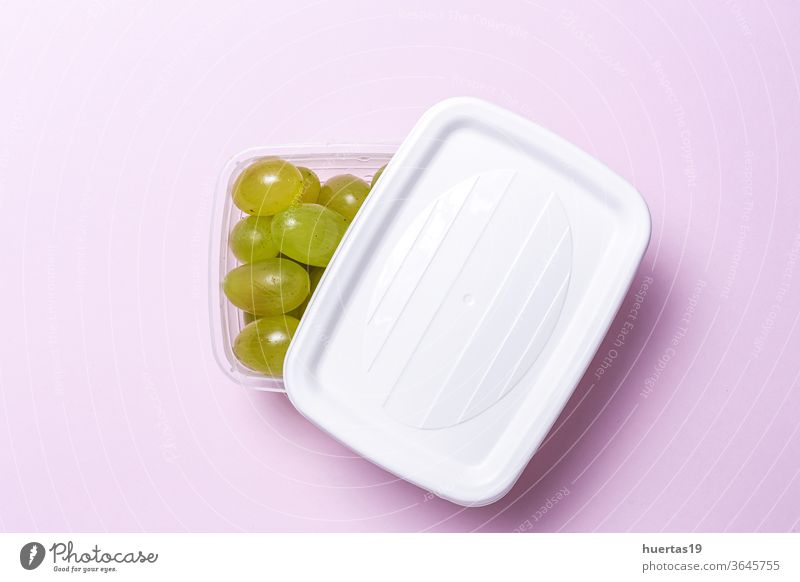 Fresh seasonal grapes in Plastic containers ready to eat To take away food plastic healthy food breakfast to take away fruit organic from above flat lay