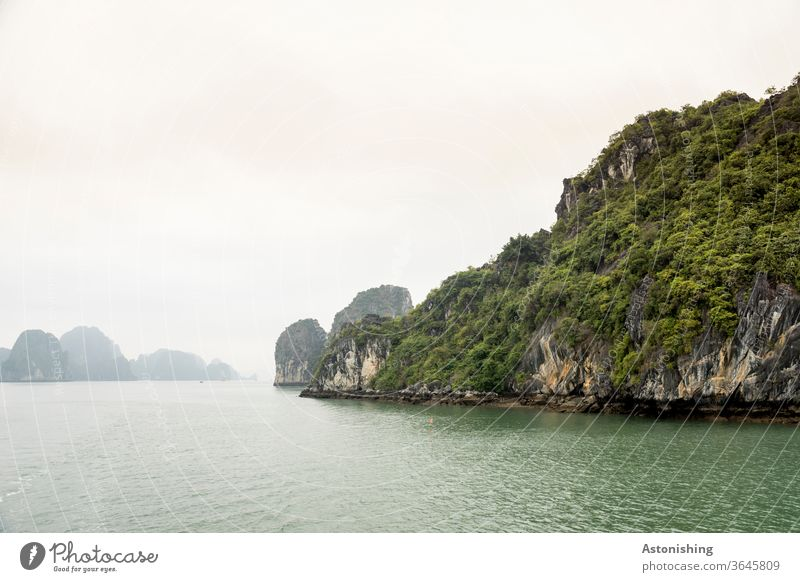 Landscape in Halong-Bay, Vietnam shrub bush shrubby green layer distance wide Waves pile Ha-Long Asia Exterior shot Vacation & Travel Stone Rock Mountain Water