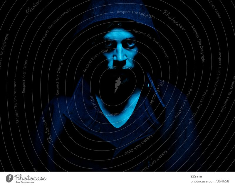 dark Masculine Young man Youth (Young adults) 18 - 30 years Adults T-shirt Coat Hooded (clothing) Facial hair Dark Creepy Cold Anger Blue Power Death Dangerous