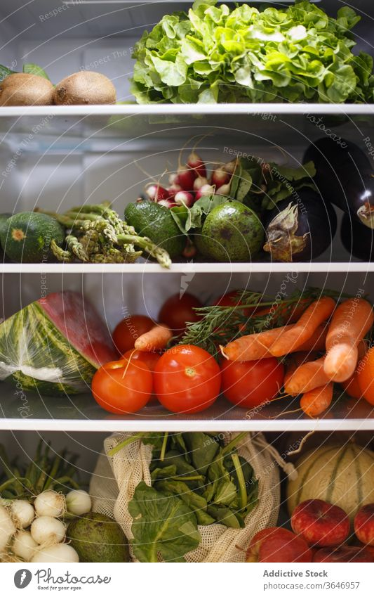 Various healthy food on shelves in fridge kitchen vegetable fruit grocery delicious organic assorted vitamin ripe home nutrition various shelf ingredient modern