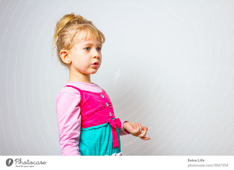 Portrait of sweet little girl as she is have comical face expression Adorable Amusing Carefree Careless Caucasian Cheerful Child Childhood Comical Crazy Cute