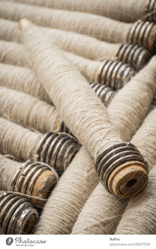 Yarn of linen for processing on the loom. Rinse yarn Roll colors variegated roll cable drum rope drum textile wickerwork Spinning mill company Company Economy