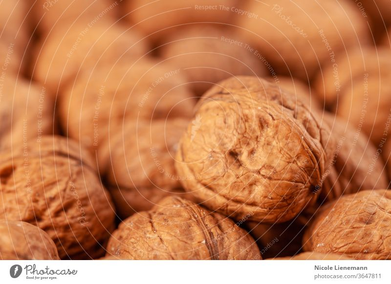 walnut on a wooden background snack cracked diet natural nature kernel brown food nutshell healthy open fruit rustic protein vegetarian season organic table
