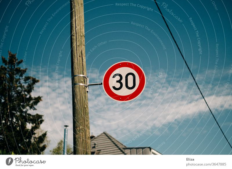 Traffic sign 30 zone. Speed limit. 30 mph zone Road sign Street Transport Signs and labeling Road traffic Blue sky Residential area attentiveness Protection