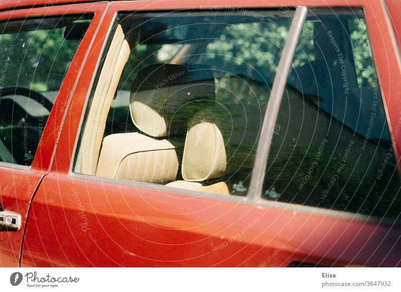 View into an old red car with beige leather seats Vehicle Old Red Retro Car Means of transport inboard interior equipment Summer Car Window Slice Window pane