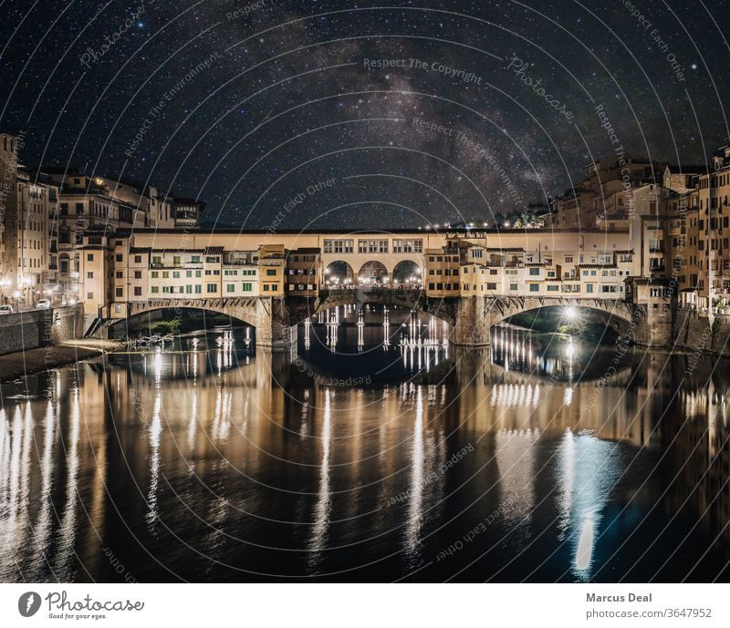 Ponte Vecchio bridge illuminated at night under the Milky Way. Florence ponte vecchio stars milky way astrophotography italy city architecture Renaissance