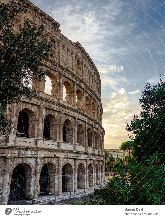 The Colosseum at sunset with clear sky Rome colosseum colosseum rome italy roman roman architecture old historical landmark tourist travel europe