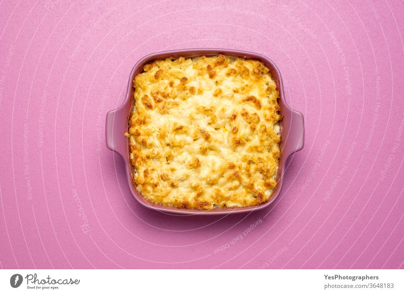 Mac and cheese oven-baked, top view. Macaroni with bechamel sauce in a pink tray above view american carbs cheddar cheesy comfort food cooked copy space cream