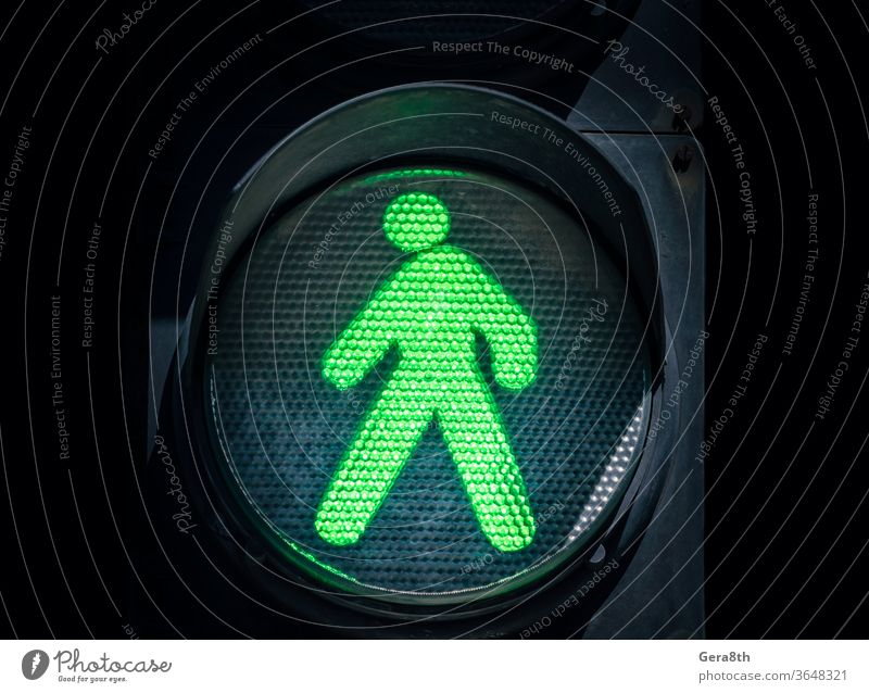 traffic light with a green man on a black background LED abstract admit allow authorize blue city close up color consent crosswalk dark dot electric enable