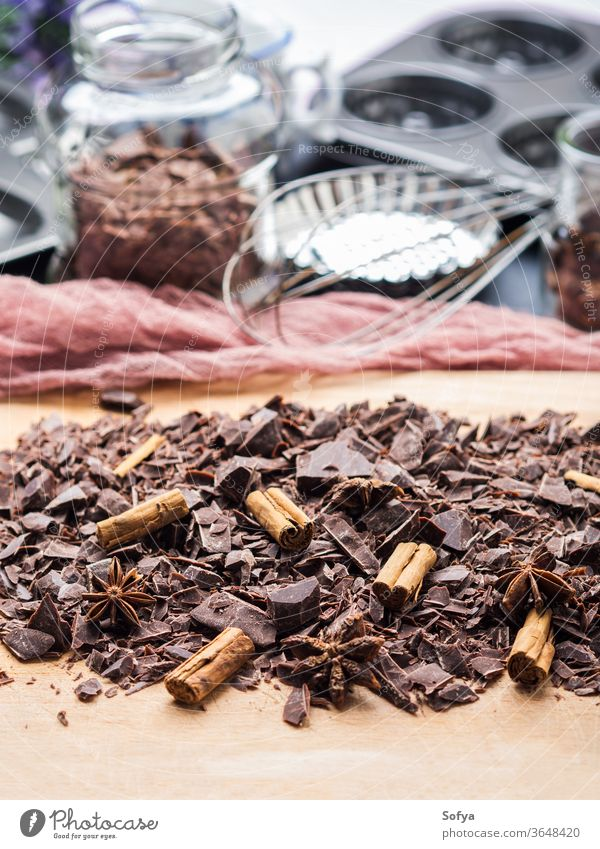 Shredded chocolate with cinnamon for baking shredded spice dark christmas food wooden board other ingredients tools sweet cooking gourmet delicious prepare