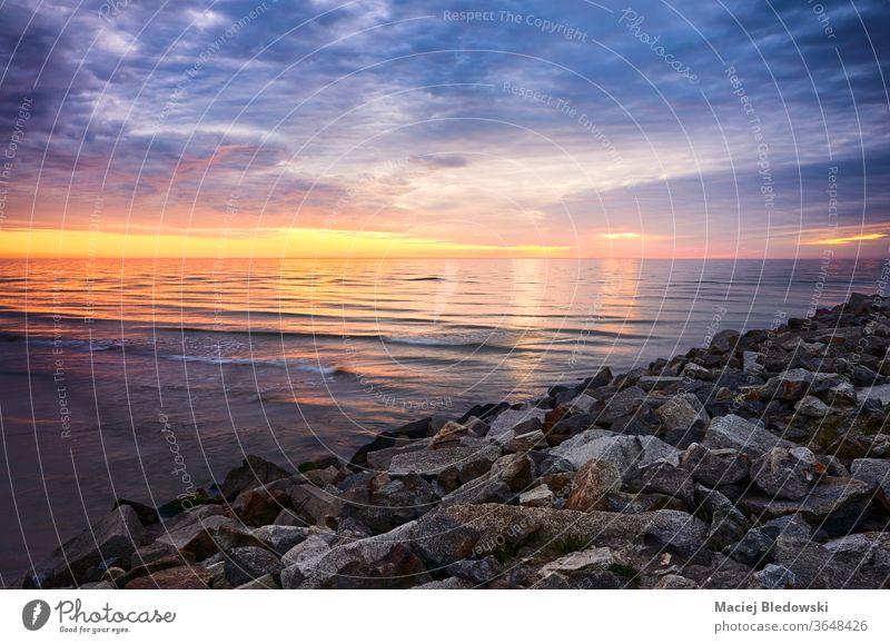 Baltic Sea rocky coast at sunset, Poland. beach sea horizon summer beautiful cloud ocean sky water nature wave seascape evening cloudscape weather Europe travel