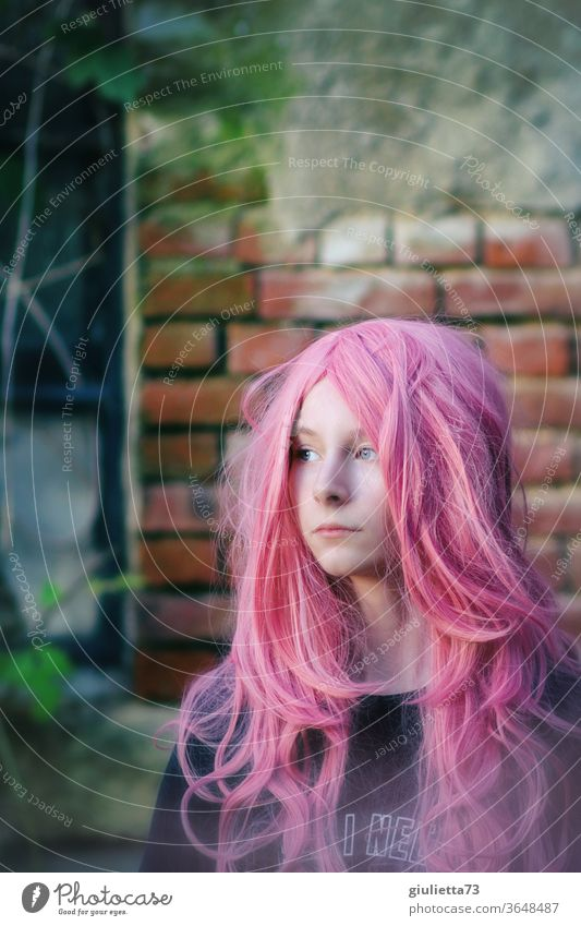 Portrait of a teenage girl with long pink hair portrait Shadow Light Day Exterior shot Colour photo Puberty Emotions Long-haired 13 - 18 years