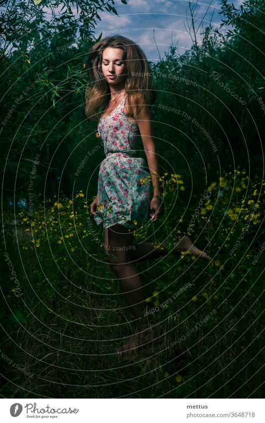 Mysterious girl running in the summer field of tall grass in the night blonde free freedom wind young woman dress candid shot beautiful fly fashion spring