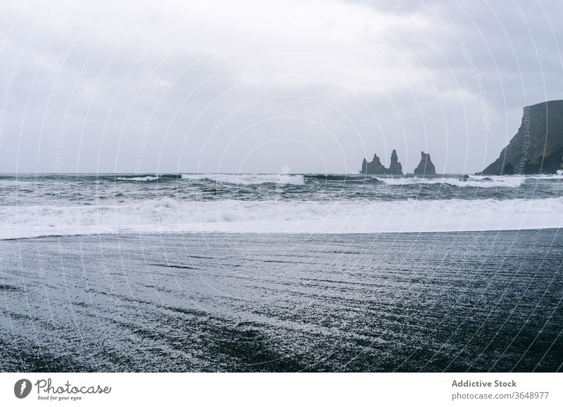 Amazing scenery with waving sea seascape majestic wave rock cloudy water foam landscape rough sky picturesque coast shore overcast mountain beach scenic weather