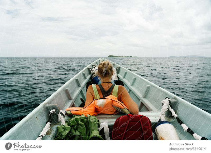 Traveling woman on boat in sea traveler wanderlust float vacation calm summer female vessel water tranquil relax trip weekend adventure serene idyllic peaceful