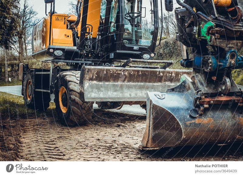 Excavator Earth machine work Construction site Industry Construction vehicle Exterior shot Colour photo Work and employment Excavator shovel Dirty