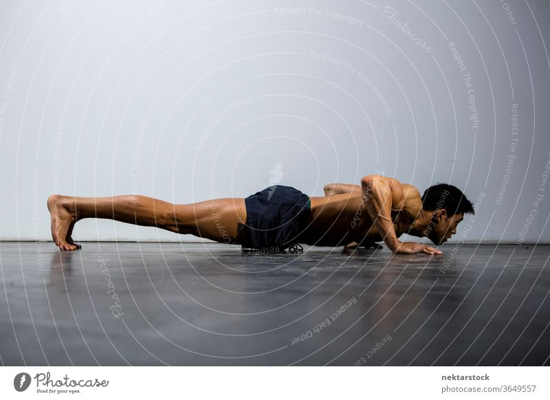 Fitness Model Doing Push-Ups Profile Nam Vo fitness model male Asian muscular muscles strength sport athletic studio shot human body physique torso shirtless