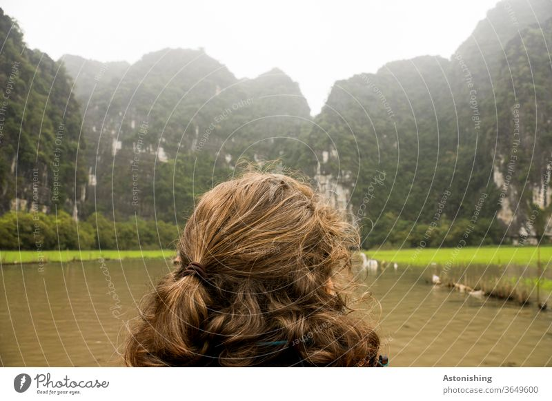 View into the mountains near Ninh Binh, Vietnam Woman hair hairstyle Landscape Back of the head look braid Hair and hairstyles Brown brunette green Nature River