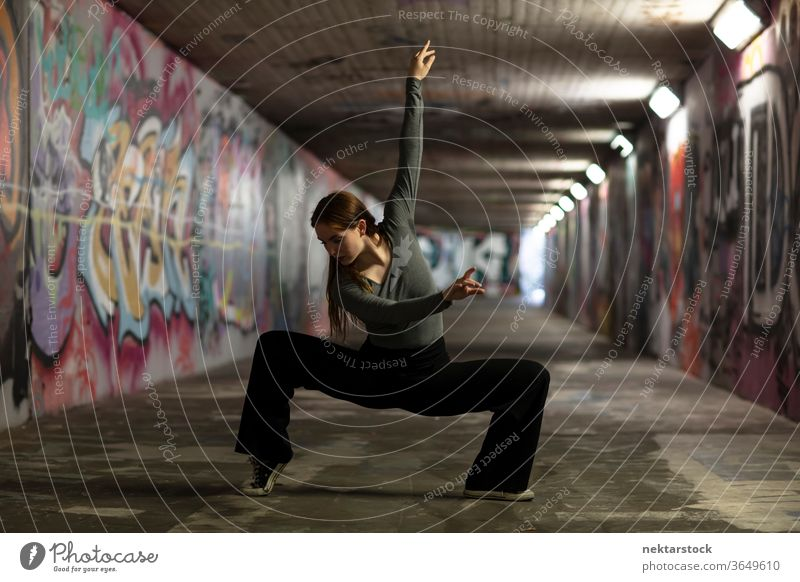 Modern Dancer Pose in City Tunnel Dancing dancer girl young woman performing arts ballet modern dance contemporary dance dance pose dance moves street performer