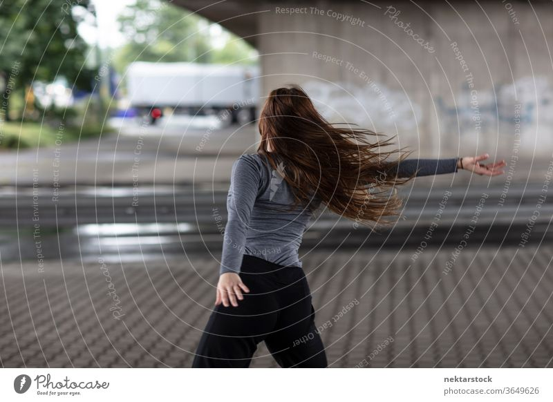 Rear View of Female Street Dancer in Motion Rear view dancer dancing motion female one person girl young woman caucasian ethnicity youth culture modern dance