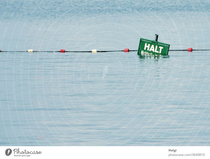 HALT - half-submerged warning sign with barrier rope at the end of a non-swimmer area in the lake Water Lake cordon holds Non-swimmer Warn Caution peril