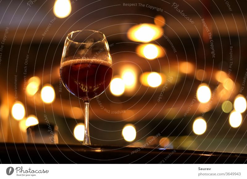 One Goblet filled with Red Wine with thumbprints on it. food and drink alcohol cuisine red wine lifestyle goblet glass wineglass sangria bar indoor lights color
