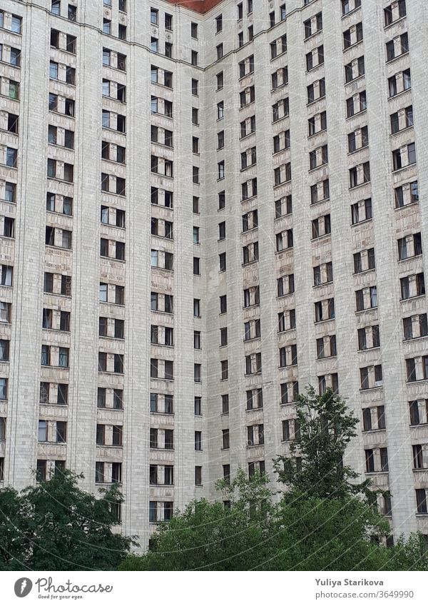Dormitory of Moscow State University. Tall block of flats with gray walls and windows. Living apartments building architecture background. accommodation