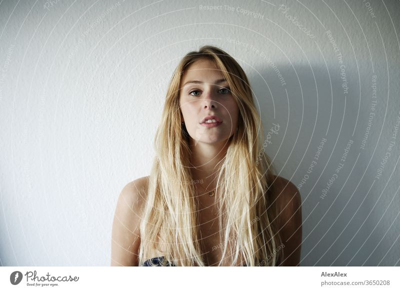 Portrait of a beautiful, young, blonde woman in front of a white wall portrait Woman Young woman Blonde already Slim Long-haired Esthetic Model Identity