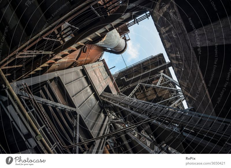 Inclined elevator at blast furnace 5 in Duisburg North. Silo Factory Process Technology Screw Lime Tank Industry Ground Funnel Fastening Gearwheel Gear rim