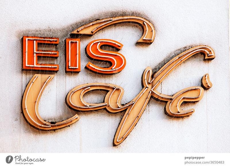 Ice Cafe Neon sign neon sign Colour photo Exterior shot Characters Letters (alphabet) Typography Signs and labeling Wall (building) Facade Word Wall (barrier)