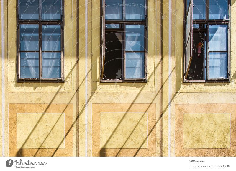 Oblique shadows on an old façade Facade Window Open Shadow diagonal curtains drapes conceit room Insight House (Residential Structure) Yellow Old Historic
