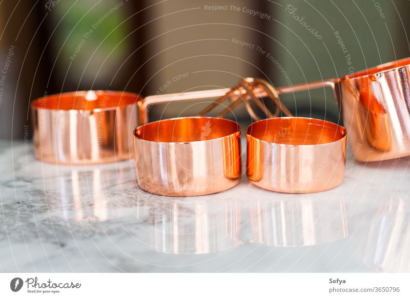Copper cups on marble. Ready to cook measuring zero waste food kitchen meal prep bulk table copper cooking process measurement weight american unit tool utensil