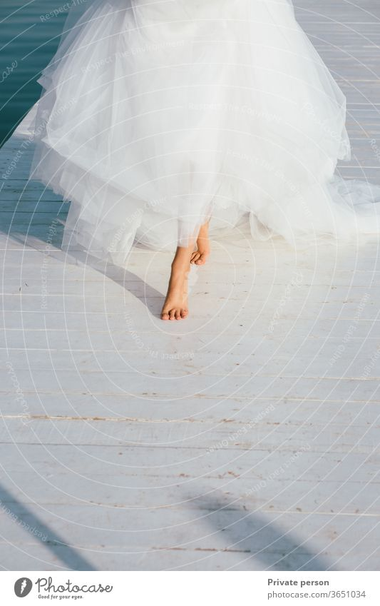 bride's bare feet as a symbol of innocence and simple joys of life barefoot wedding white engagement freedom Wedding Bride Bride groom Love
