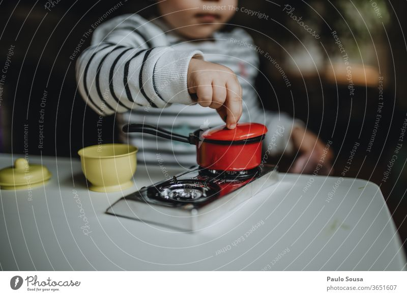 Child cooking with toys at home Children's game childhood Playing Cooking Toys simulation Infancy Joy Colour photo Human being Parenting Girl Day Kindergarten