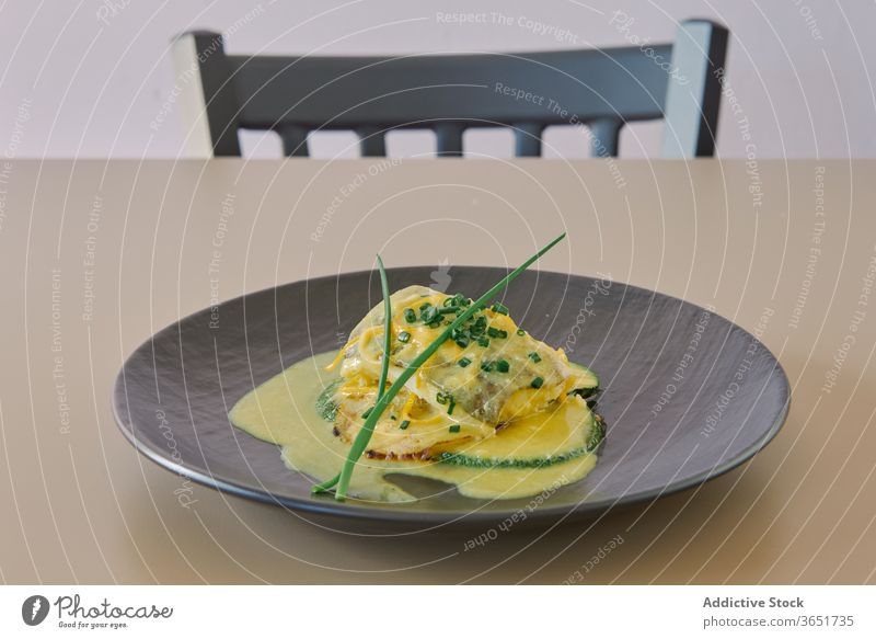Tasty fish dish with zucchini decorated with green onion dinner gastronomy lunch delicious meal gourmet sprig slice butter sauce healthy lemon zest nutrition