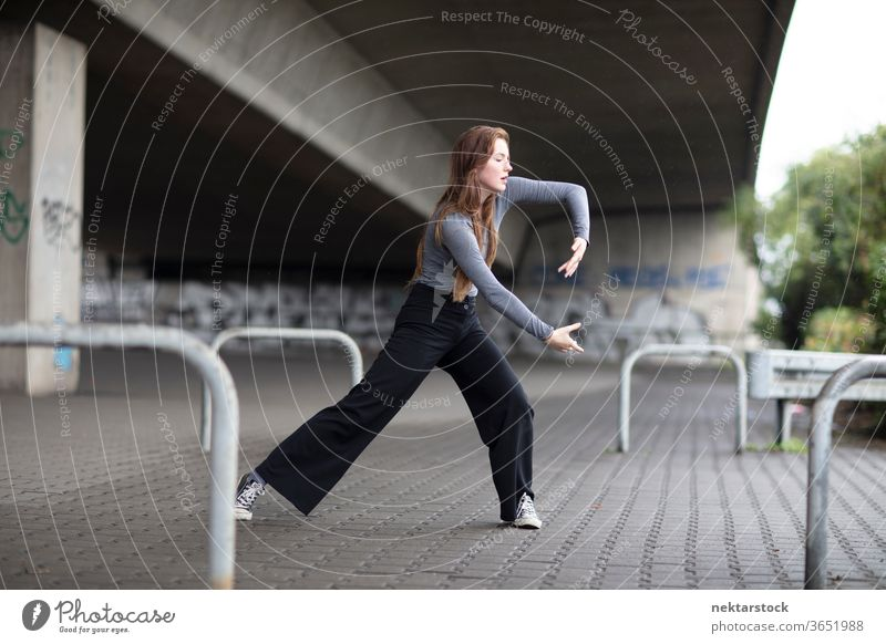 Street Dancer in Motion on Sidewalk female dancer modern dance street dance sidewalk one person girl young woman caucasian ethnicity youth culture full length
