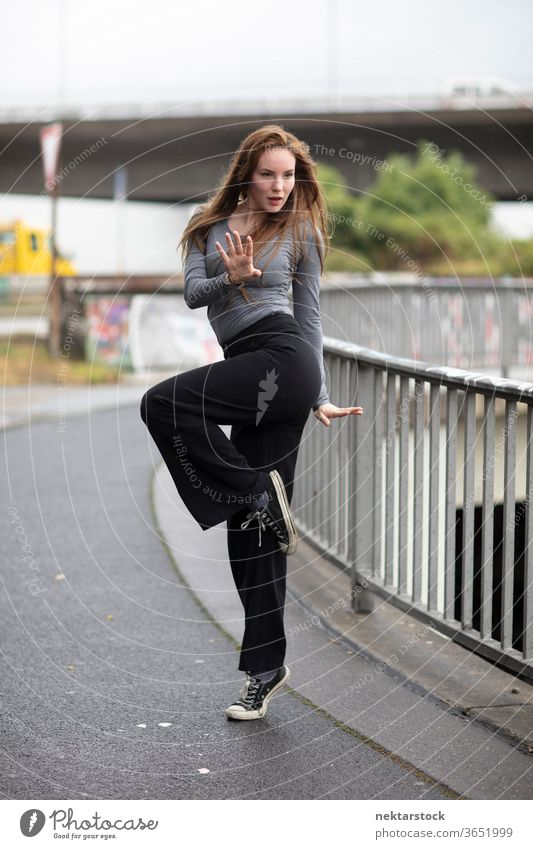 Street Dancer in One Leg Stand female dancer modern dance portrait street dance sidewalk one person girl young woman caucasian ethnicity youth culture