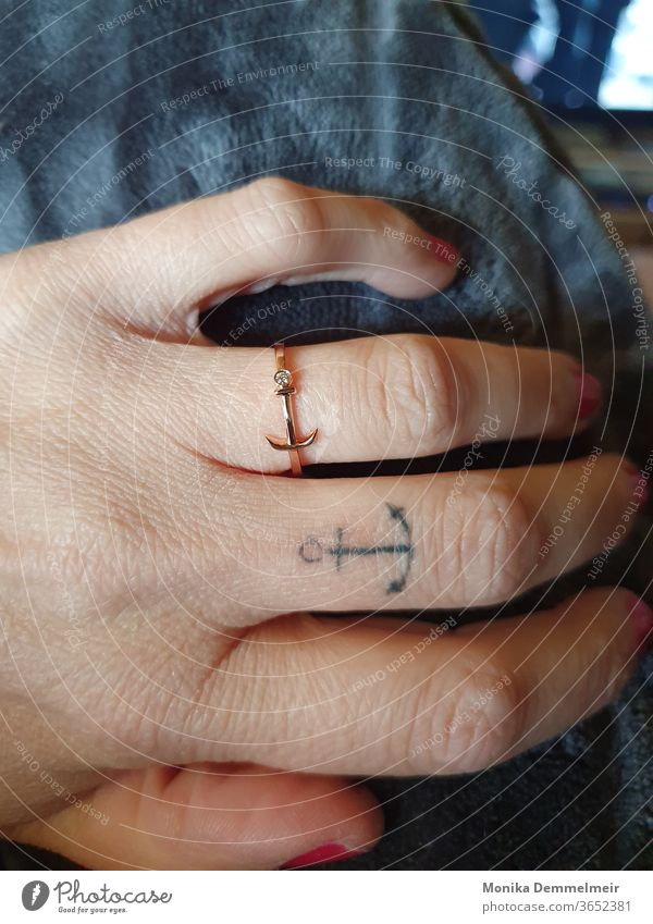 Anchor love that gets under your skin Navigation Ocean Tattoo Tattoo cover Ring by hand Woman Feminine Fingers Human being Skin Tattooed tattooing Colour photo