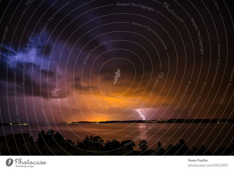 A thunderstorm over the Bodensee provides for a beautiful play Thunder and lightning Lake Constance lightning bolt Clouds Water Gale Storm Idyll Nature