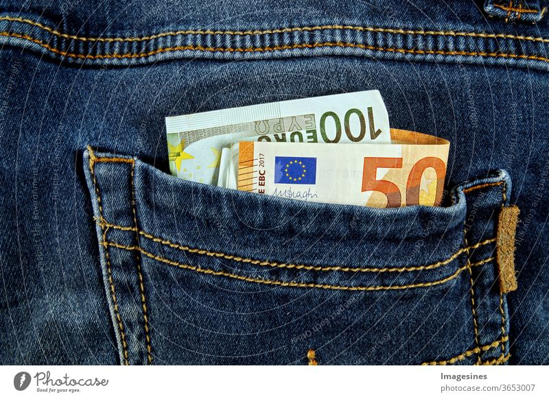 Euro banknotes in the pockets of the jeans. Just steal the money. Pickpockets Money Loose change Euros Banknote Bag Jeans Pants concept Luxury Save Euro notes