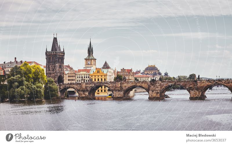 Charles Bridge, Prague famous landmark, Czech Republic. city architecture Vltava river town toned cityscape filtered view building urban Europe instagram effect