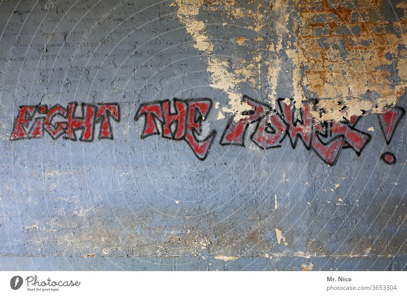 Fight against the power ! Graffiti Wall (building) Characters Facade built Gray lettering Characters and letters Dirty powerful Politics and state Abstract