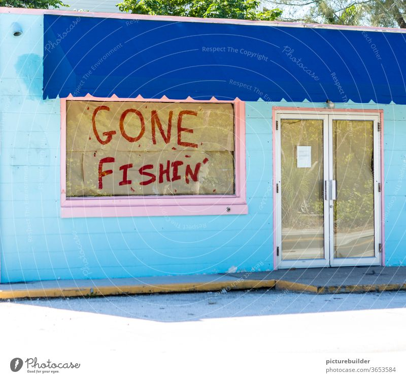Closed shop with absence notice Gone Fishing Load Window door glued pasted up gone fishing Blue Pink broke business discontinuation Store premises built