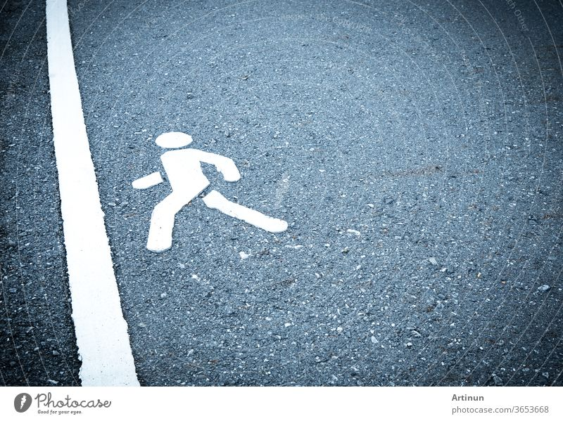 White painted sign on asphalt. People are going to step into the finish line. Do not be afraid to step over obstacles concept. pedestrian lane abstract