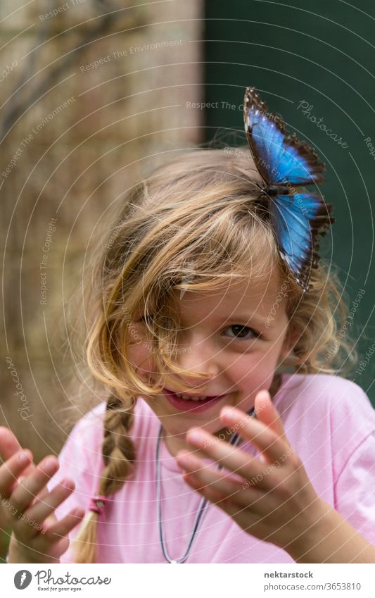 Portrait of Happy Blond Girl With Blue Butterfly in Hair child portrait happy girl smiling outdoor nature beauty in nature blue day summer caucasian ethnicity
