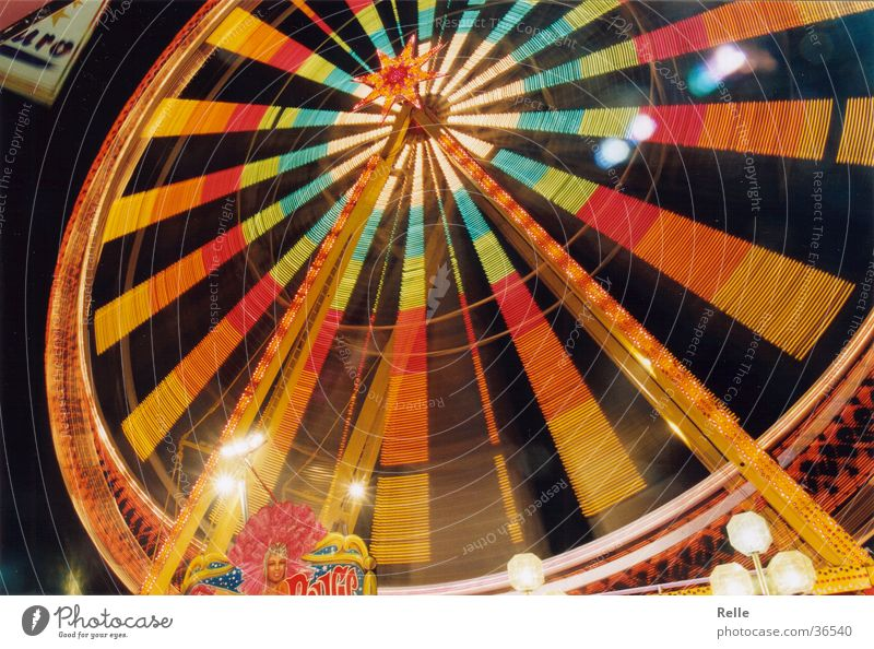 beautifully colorful Ferris wheel Fairs & Carnivals Speed Multicoloured Long exposure Theme-park rides Evening fair Light Partially visible Bright Contrast