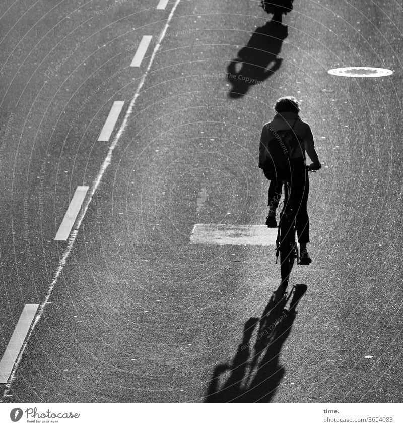 closing time Bicycle Cyclist Street Asphalt Tar mark B/W Shadow Silhouette Line cycle path Back-light Rear view Movement In transit