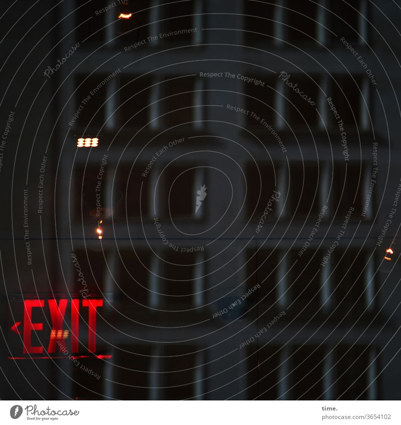 At the end of the night please keep left exit Way out Red conceit at night Artificial light reflection somber Mysterious Inspiration Creepy Direction Arrow